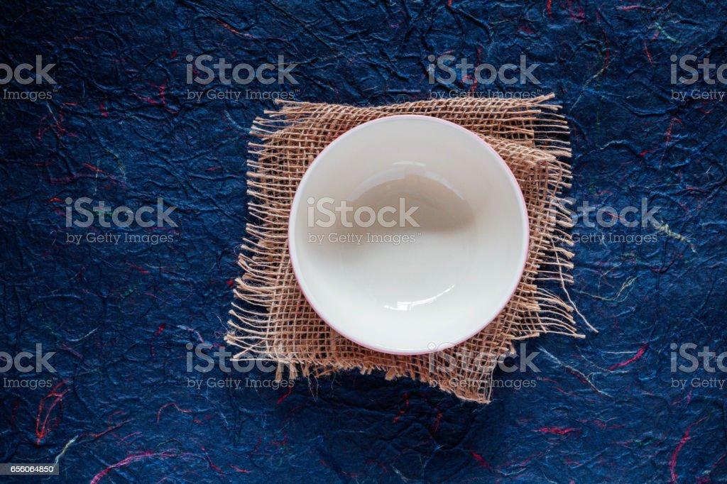 bowl on blue background. stock photo