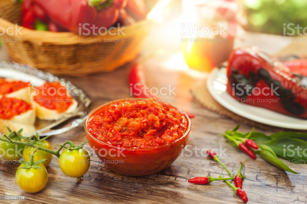 Bowl with ajvar on the table stock photo
