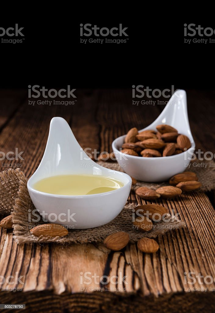 Bowl with almond oil (selective focus) stock photo