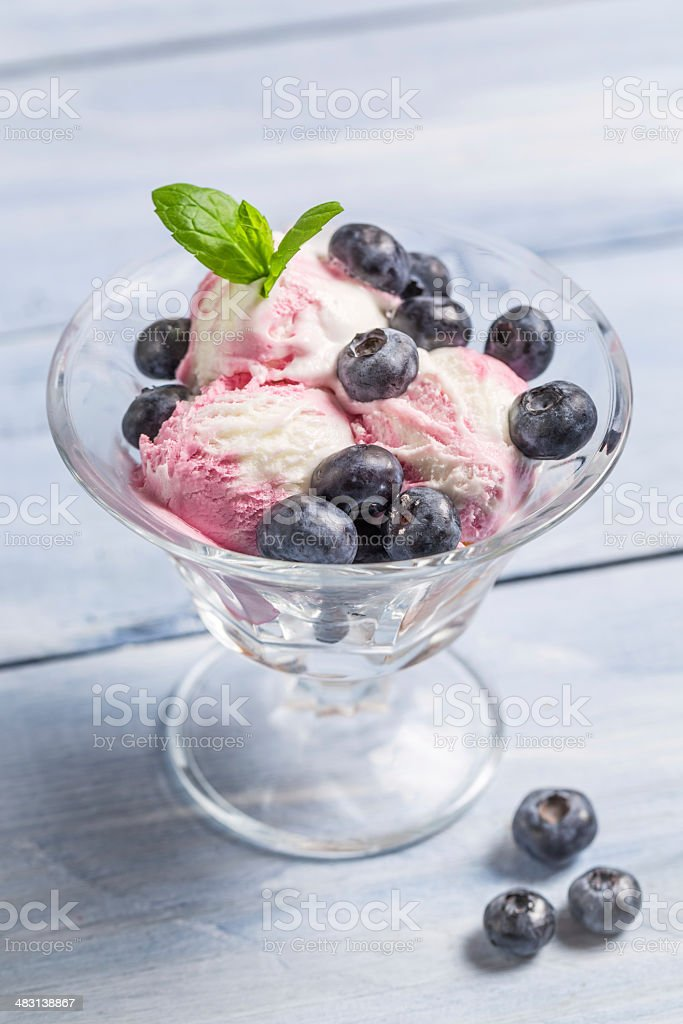 Bowl with blueberry ice cream and leaf mint stock photo