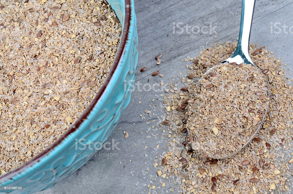 Bowl with bran and silver spoon stock photo