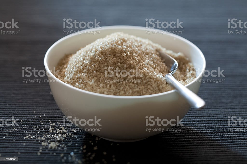 Bowl with brown sugar royalty-free stock photo