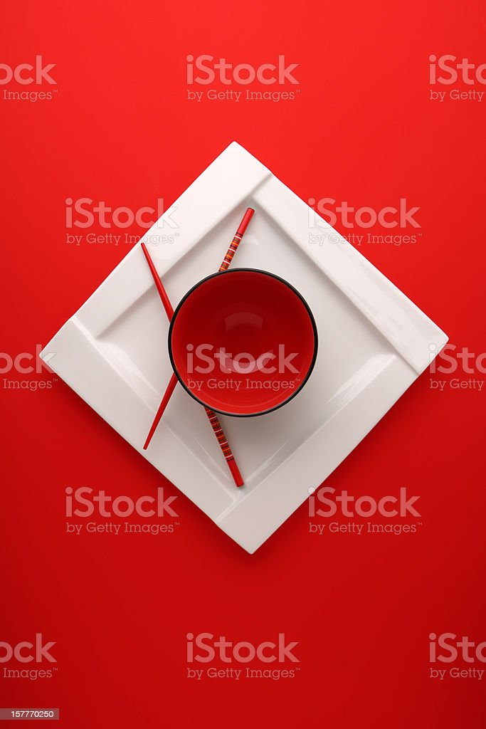 Bowl with chopsticks and white plate stock photo
