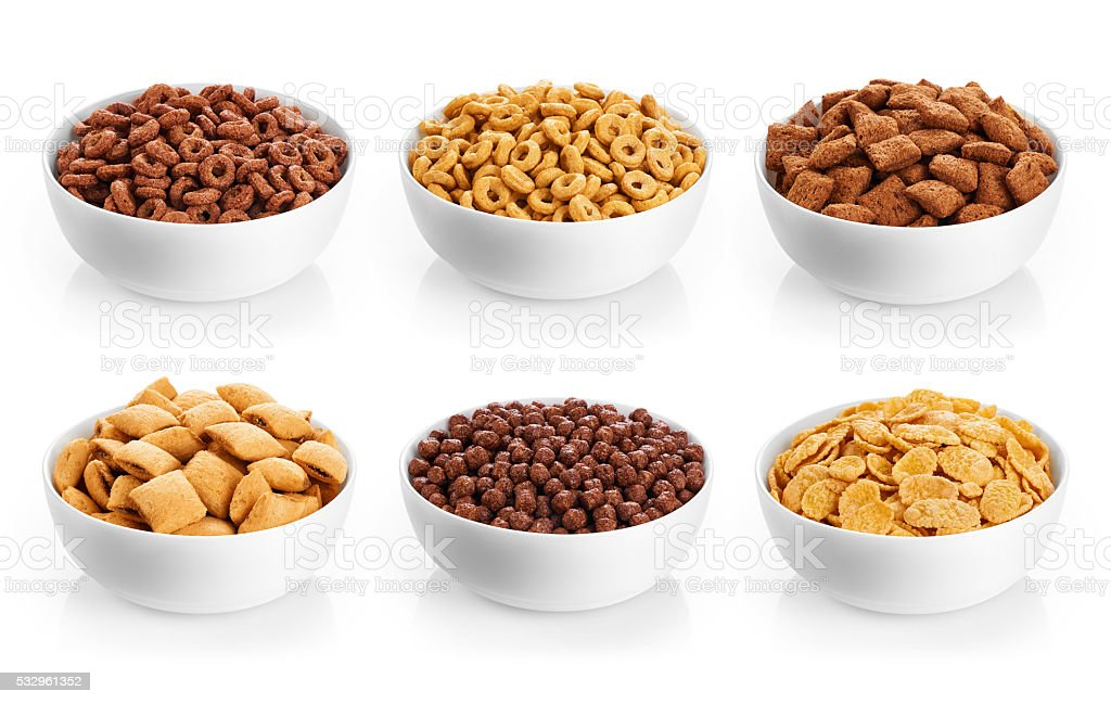 Bowl with corn pads, rings, balls and cornflakes stock photo