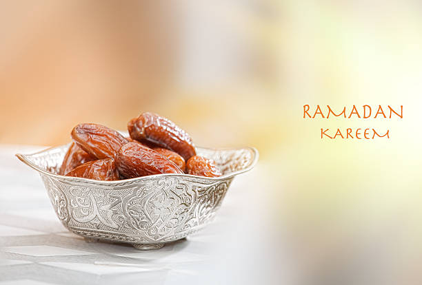 bowl with dates - ramadan stock photos and pictures