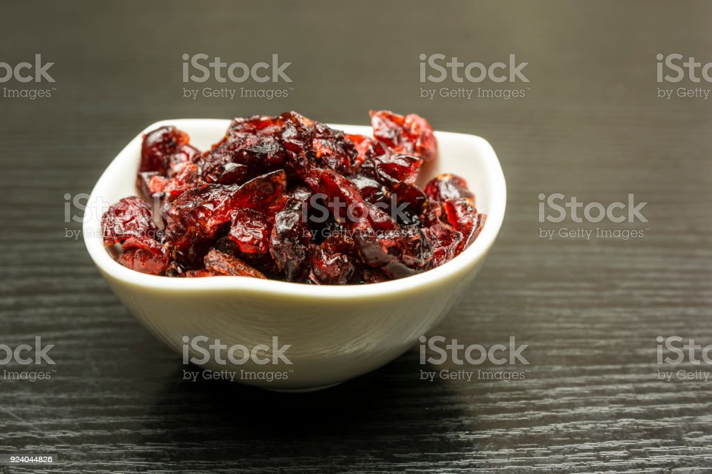 Bowl with dried cranberries. stock photo