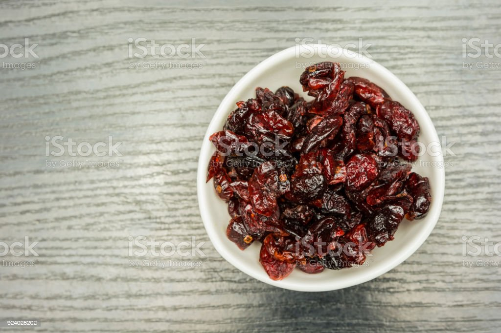 Bowl with dried cranberries. View from above. stock photo