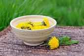 Bowl with flowerheads of dandelion.