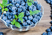Tasty fresh blueberries heathberry on rustic wooden background. Blueberries are healthy antioxidant organic superfood.