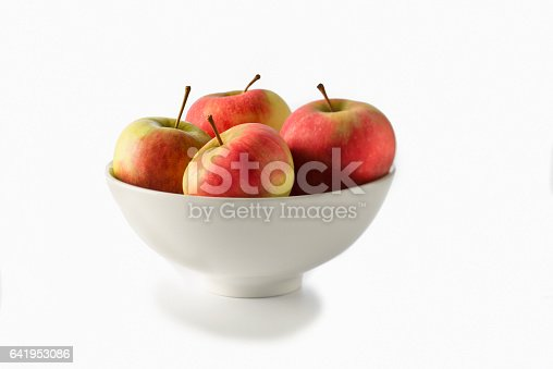 Diet of apples for less weight and healthy living.  bowl of four red apples on a white background.