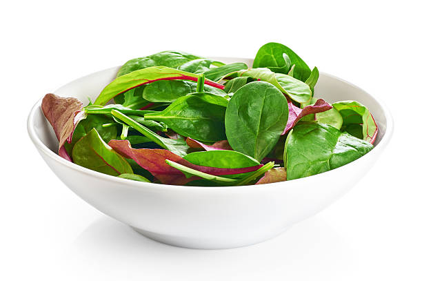 Bowl with fresh green salad isolated on white background. stock photo