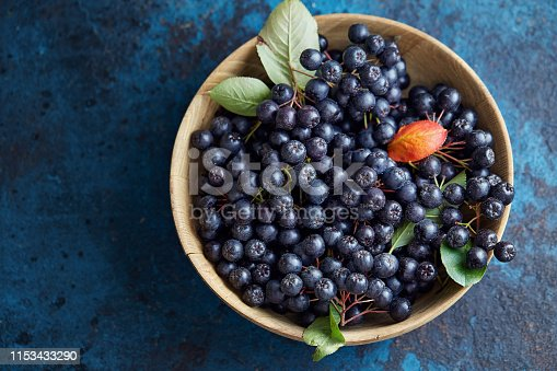 istock Bowl with freshly picked homegrown aronia berries. 1153433290