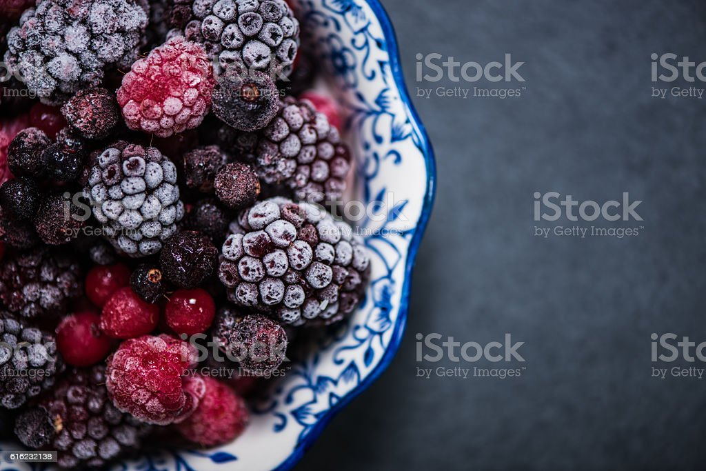 Bowl with frozen black forest fruits – Foto
