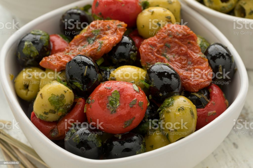 Bowl with green and black olives, peppers and tomatoes zbiór zdjęć royalty-free