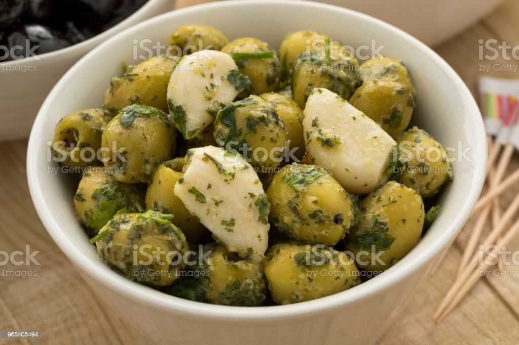 Bowl with green olives, garlic and cilantro royalty-free stock photo