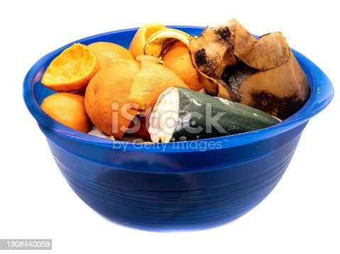 Bowl with kitchen waste isolated on white background