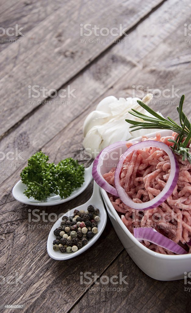 Bowl with Minced Meat on wood royalty-free stock photo