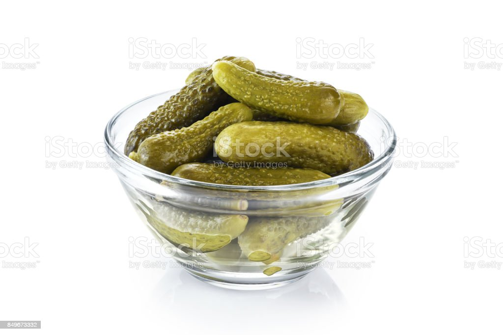 Bowl with pickled cucumbers isolated on white background. stock photo