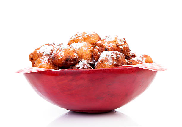 bowl with pile of dutch donut also known as oliebollen - oliebollen stockfoto's en -beelden