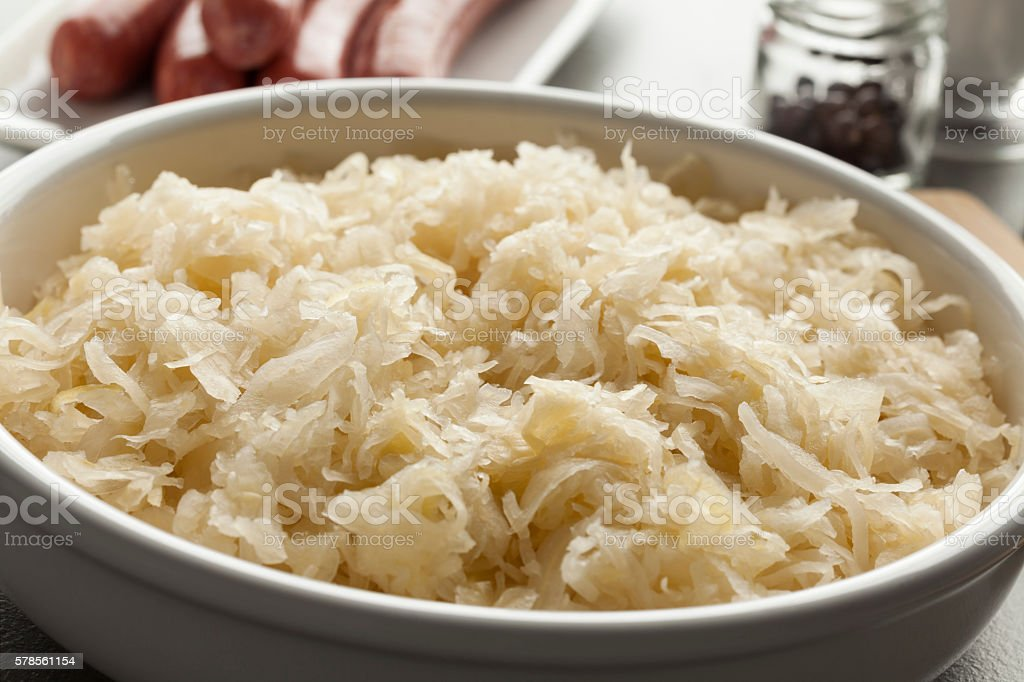 Bowl with raw preserved sauerkraut stock photo