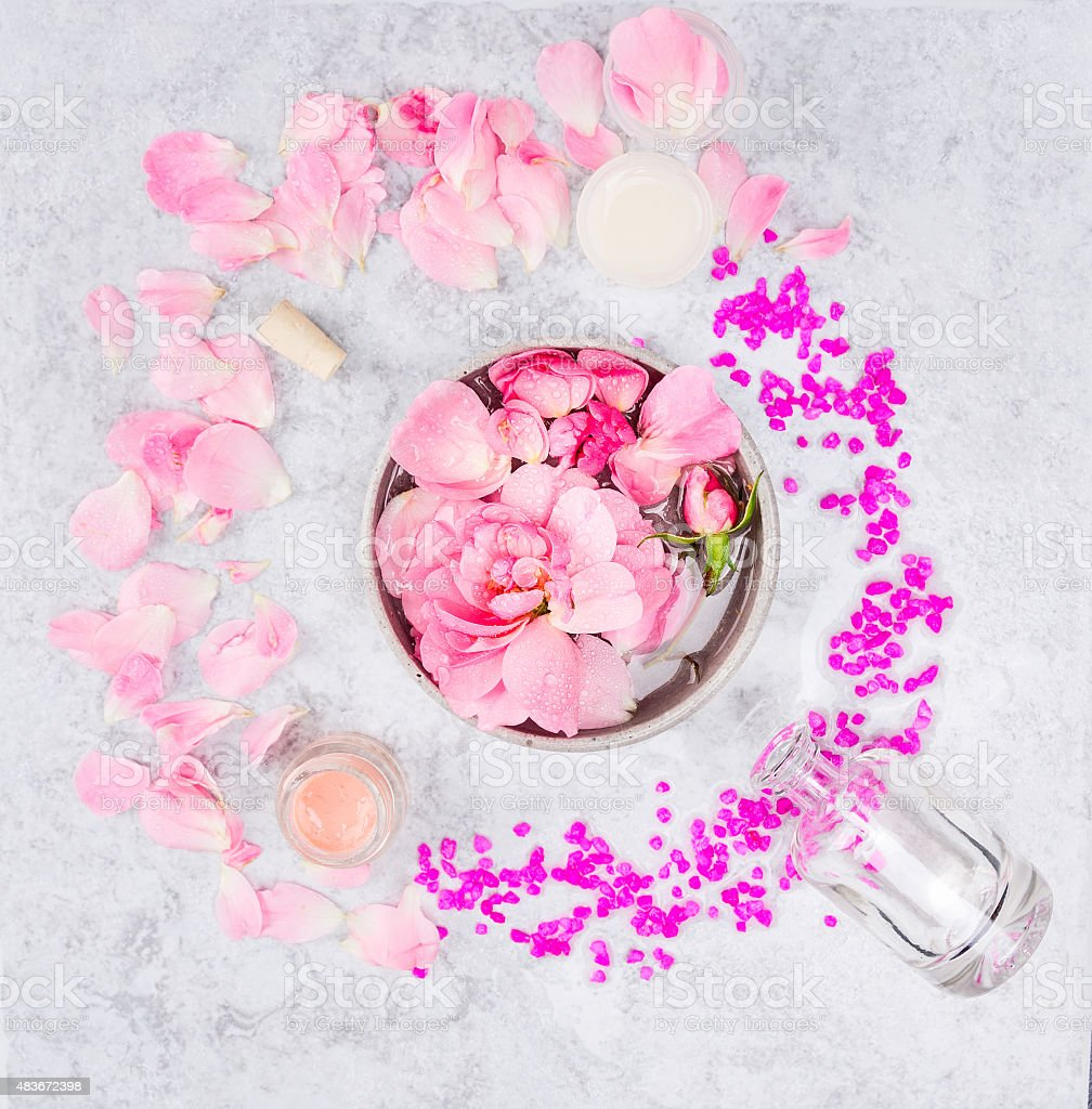 bowl with roses and water,jars of cream on marble stock photo