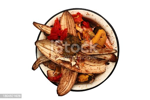 Bowl with rotten banana skins and other kitchen waste