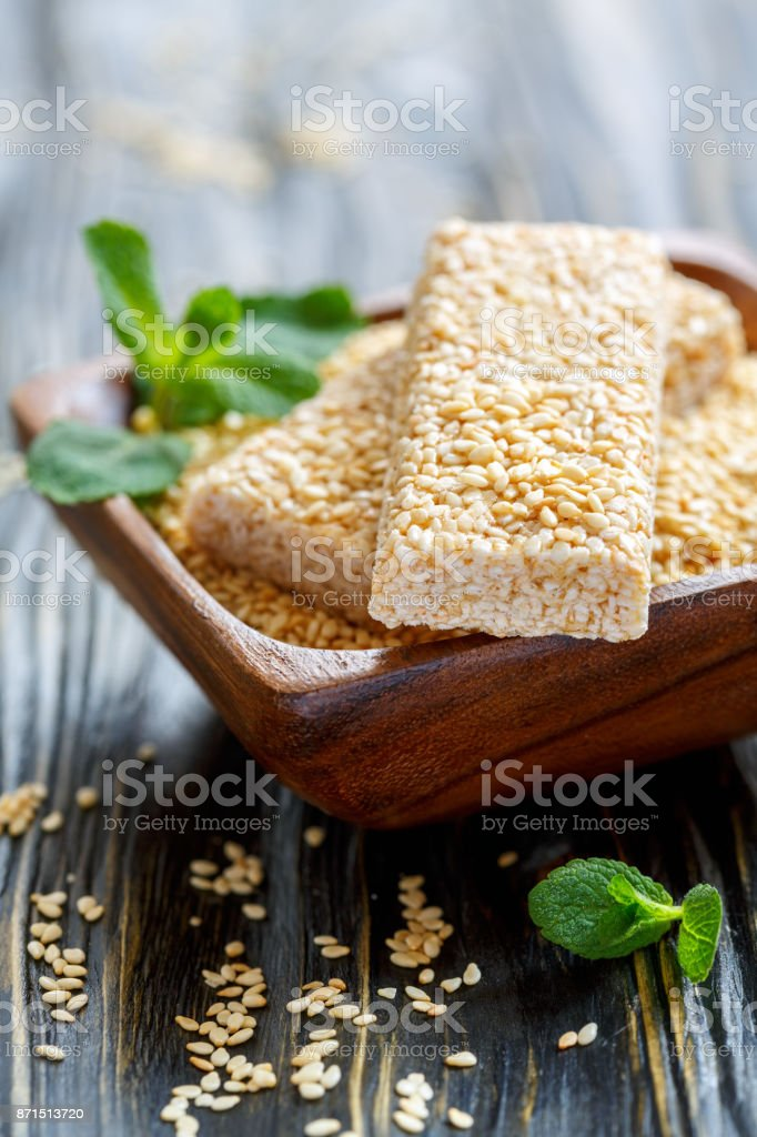 Bowl with sesame seeds and honey bars with sesame seeds. stock photo
