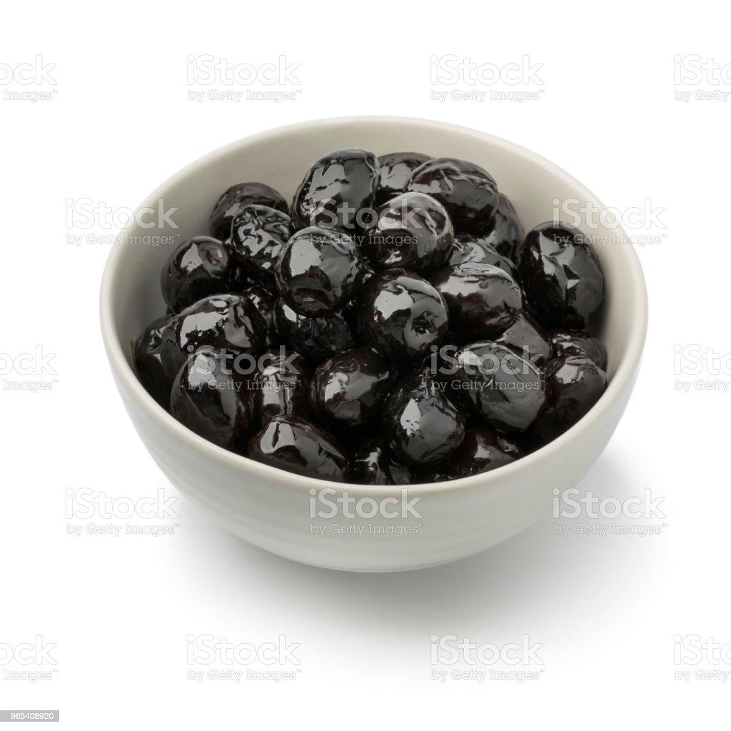 Bowl with shiny black olives royalty-free stock photo