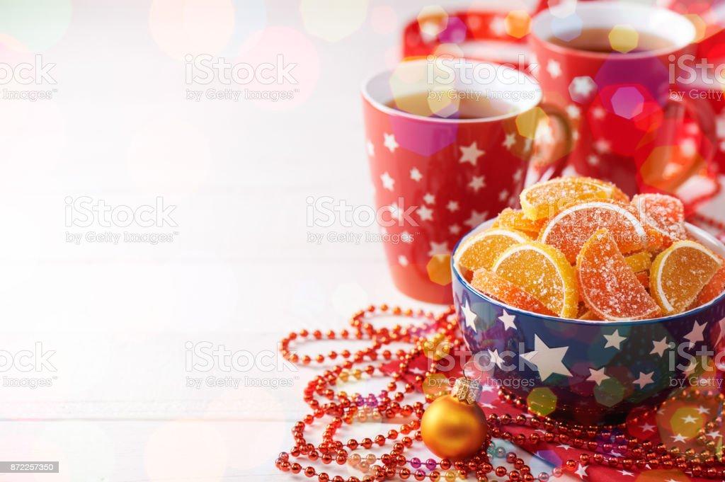 Bowl with slices of marmalade shaped like lemon and orange, christmas decorations, many star stock photo