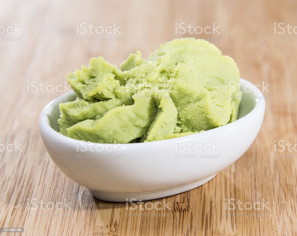 Bowl with Wasabi on wood stock photo