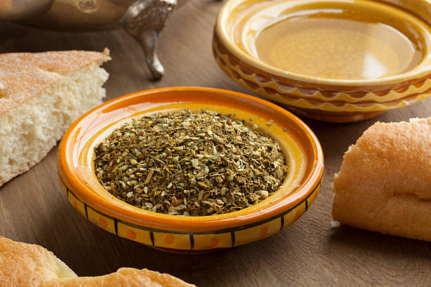 Bowl with Za'atar, olive oil and bread Bowl with Za'atar, olive oil and bread for breakfast zaatar spice stock pictures, royalty-free photos & images