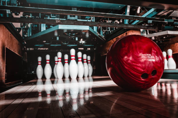 bowling ball and pins stock photo
