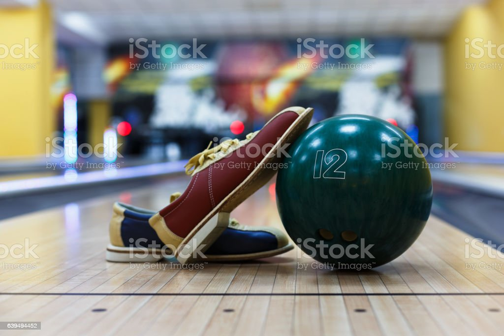 Bowling ball and shoes on lane background stock photo