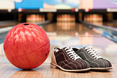 istock Bowling ball and shoes on lane 93245771