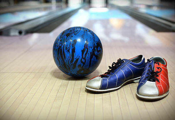 Bowling ball and shoes. stock photo