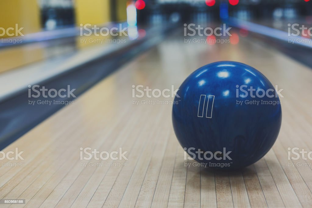 Bowling ball closeup on lane background stock photo
