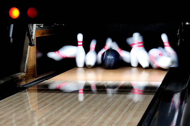 Bowling ball flying down lane and huffing a strike stock photo