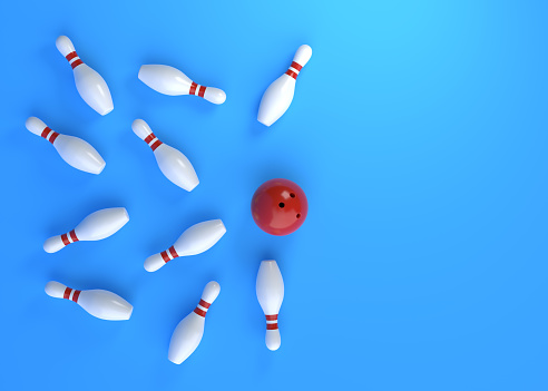 Bowling ball hits all the skittles on blue background. Creative minimal concept. 3d rendering illustration