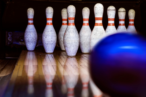 Bowling - ball in motion - focus on pins