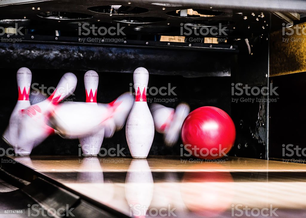 Bowling ball hitting its target.