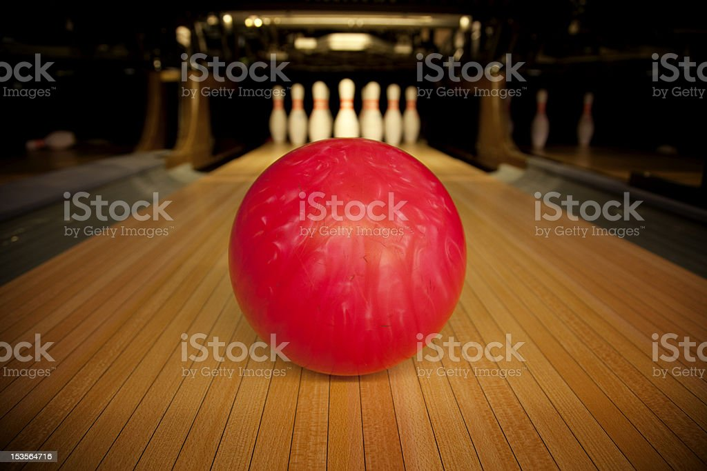 Bowling ball set in front of ten pins stock photo