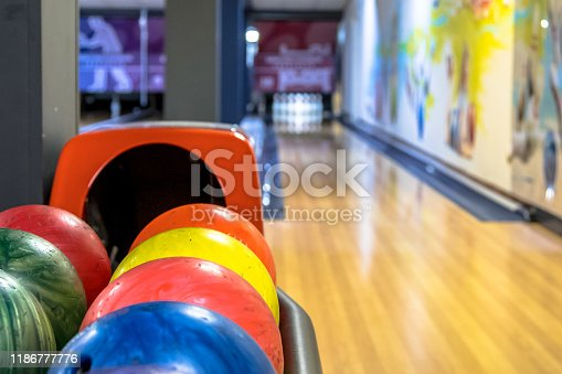 Bowling balls in a row waiting to be thrown at bowling club