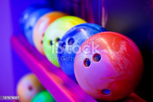 Bowling balls on ball shelves. Cosmic bowling colors.