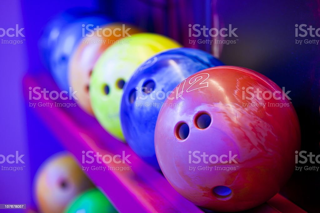 Bowling balls on ball shelves stock photo