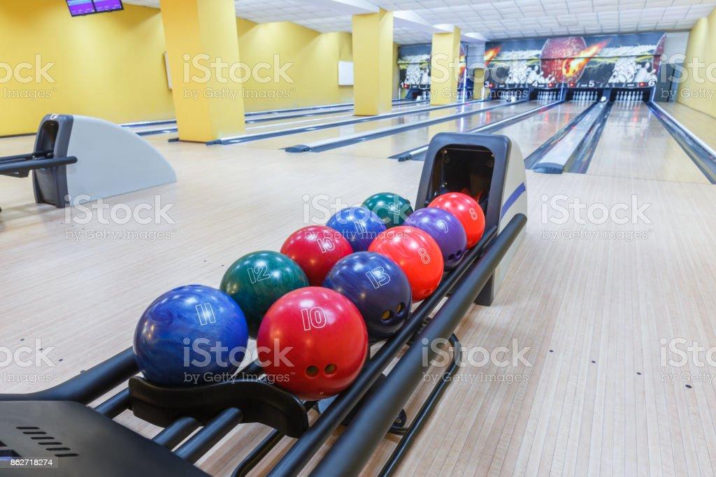 Bowling balls return machine, alley background stock photo