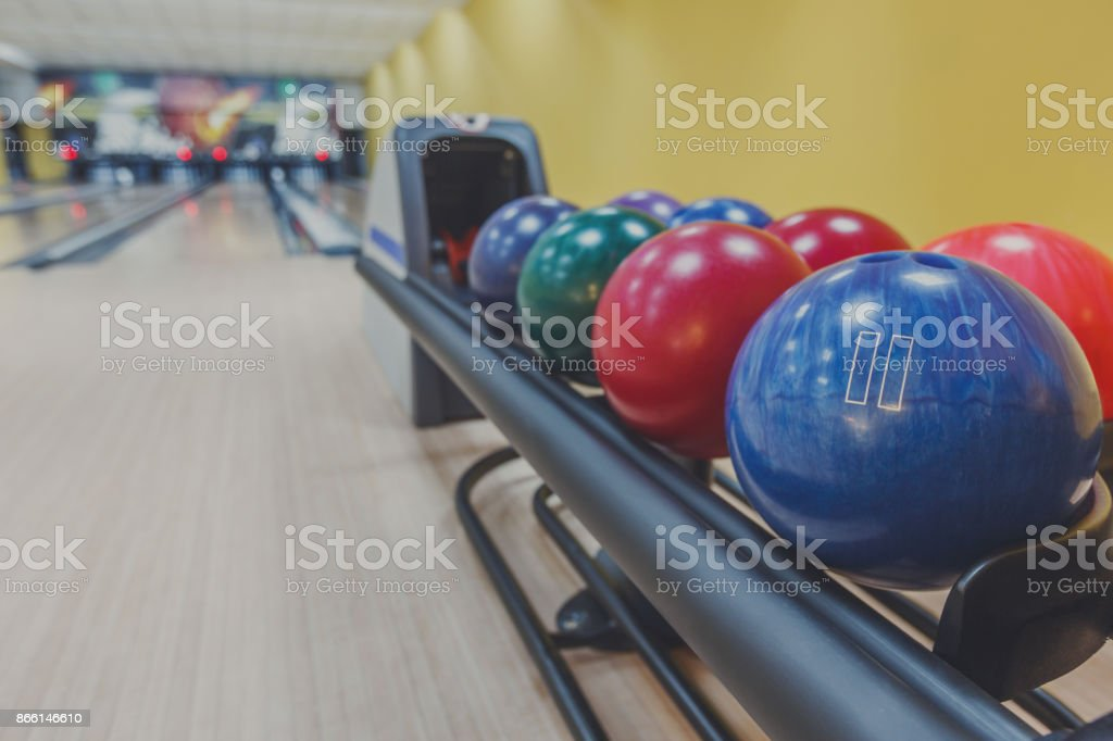 Bowling background. Interior of bowling alley lane with balls return...
