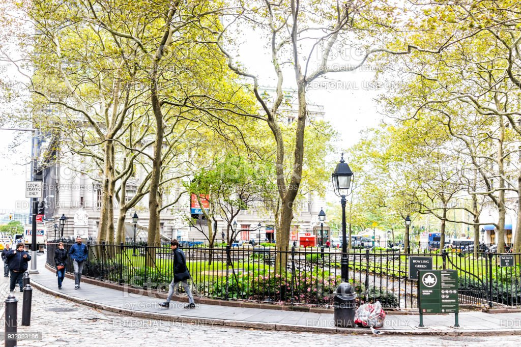 Bowling Green small public park in Financial District Lower Manhattan, Broadway street NYC downtown stock photo