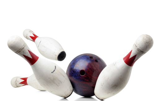 Bowling ball and pins mid-air on white background.  Please see my portfolio for other sport images.