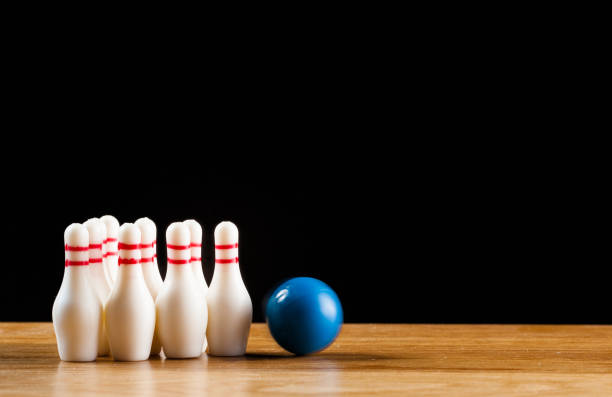 Bowling pins and bowling ball in miniature stock photo