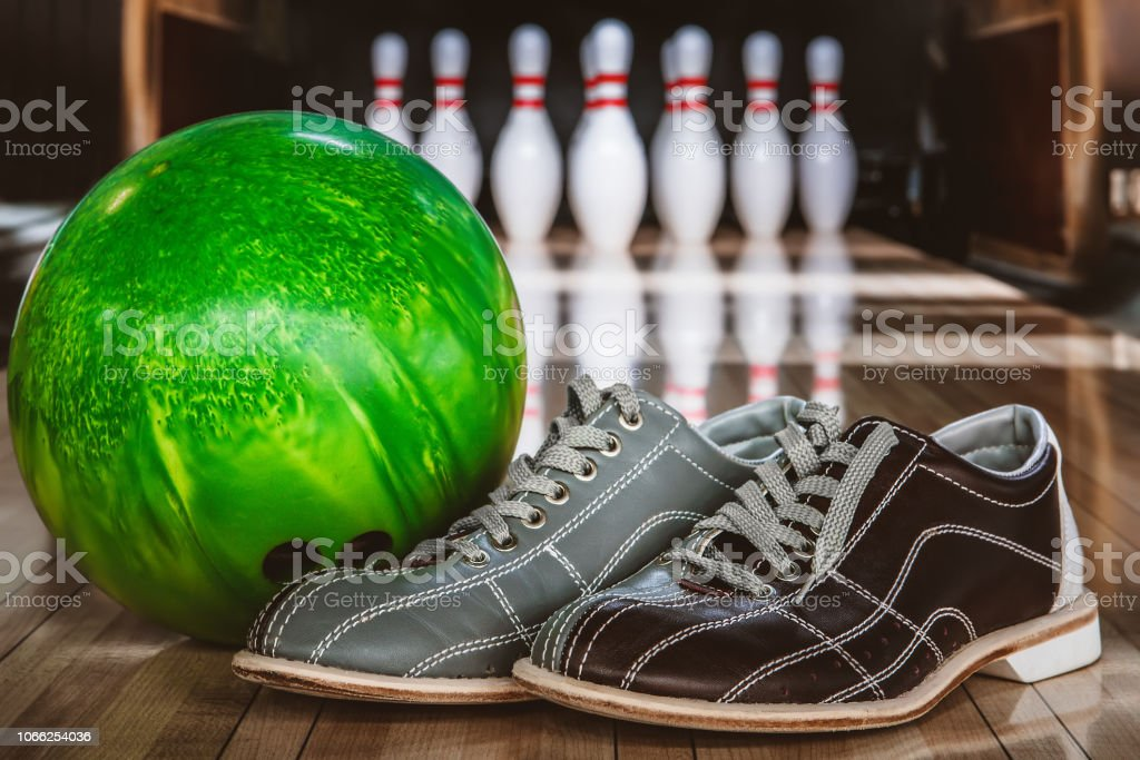bowling pins, balls and shoes stock photo